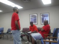 RAGE members David, Emmanuel, and Antoine speaking to the youth from Englewood