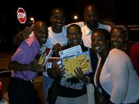RAGE Members Passing out Books at the Love Young People Tour
