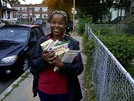 RAGE Member Sonya Harper Passing Out Books to Young People