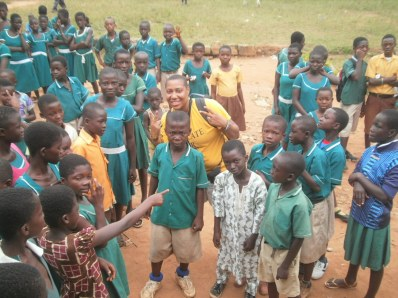 President of RAGE with Students in the Abira Village