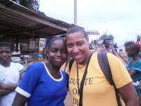 Aysha Butler with student in Abira
