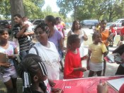 RAGE Members distributing back to school supplies
