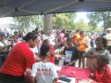 RAGE Members distributing back to school supplies